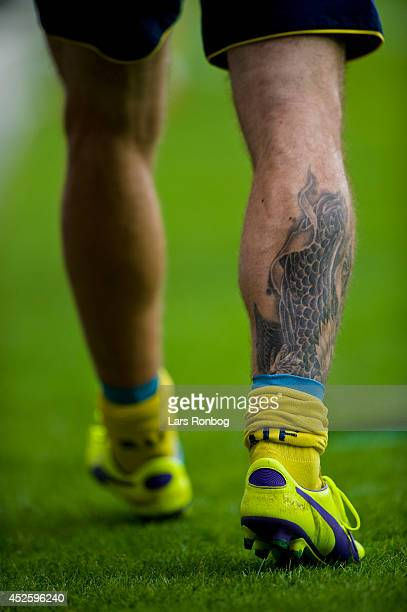 Tattooed legs of Mikkel Thygesen of Brondby IF during warming up during the Danish Superliga match between FC Midtjylland and Brondby IF at MCH Arena...