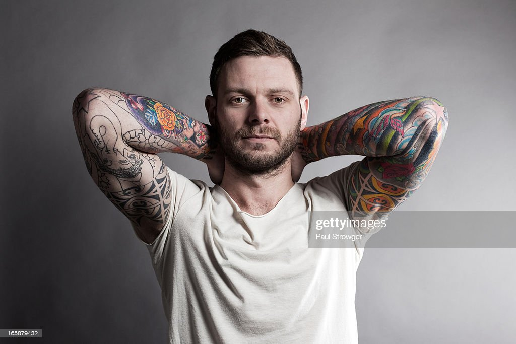 Tattooed Male, Hands on Neck.