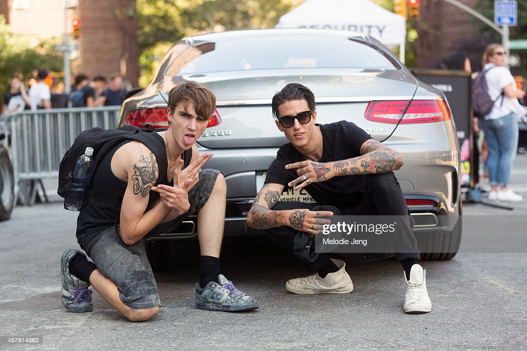 Tattooed male models Gryphon O'Shea and Miles Langford outside Lincoln Center on Day 1 of New York Fashion Week Spring/Summer 2015 on September 4, 2014 in New York City.