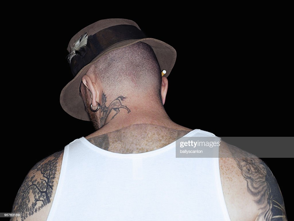 Tattooed Man With Hat and Cigarette in Ear. : Stock Photo