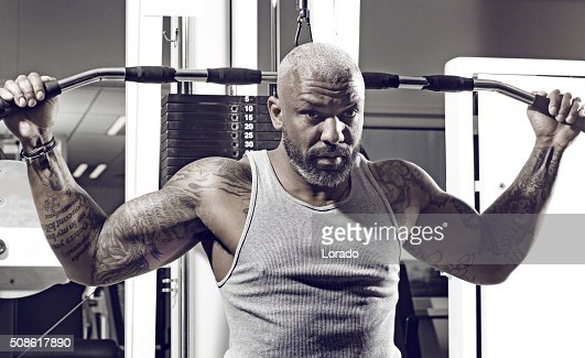 Tattooed middle aged bearded black man at a gym : Stock Photo