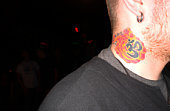 Tattooed neck of rock performer