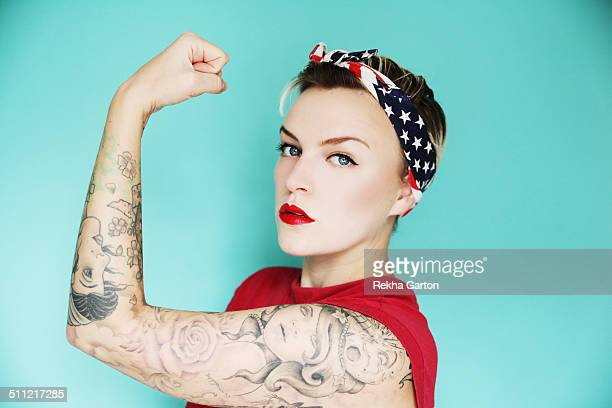 Tattooed Pin up woman showing her arm off