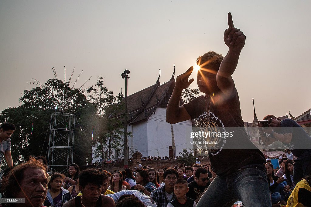 A tattooed Thai devotee enters in state of trance during sunrise as he tries to pay his respect to a statue of Khru Sak during the celebration of the...