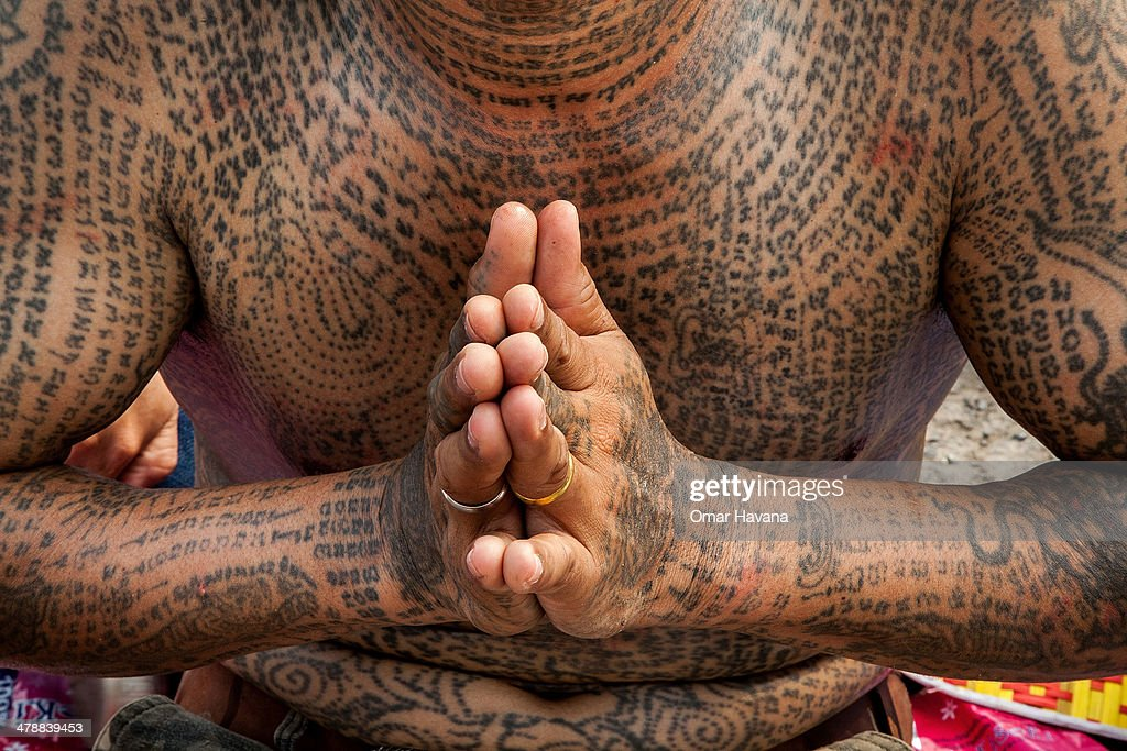 A tattooed Thai devotee prays during the celebration of the annual Tattoo festival at Wat Bang Phra on March 15 2014 in Nakhon Pathom Thailand...