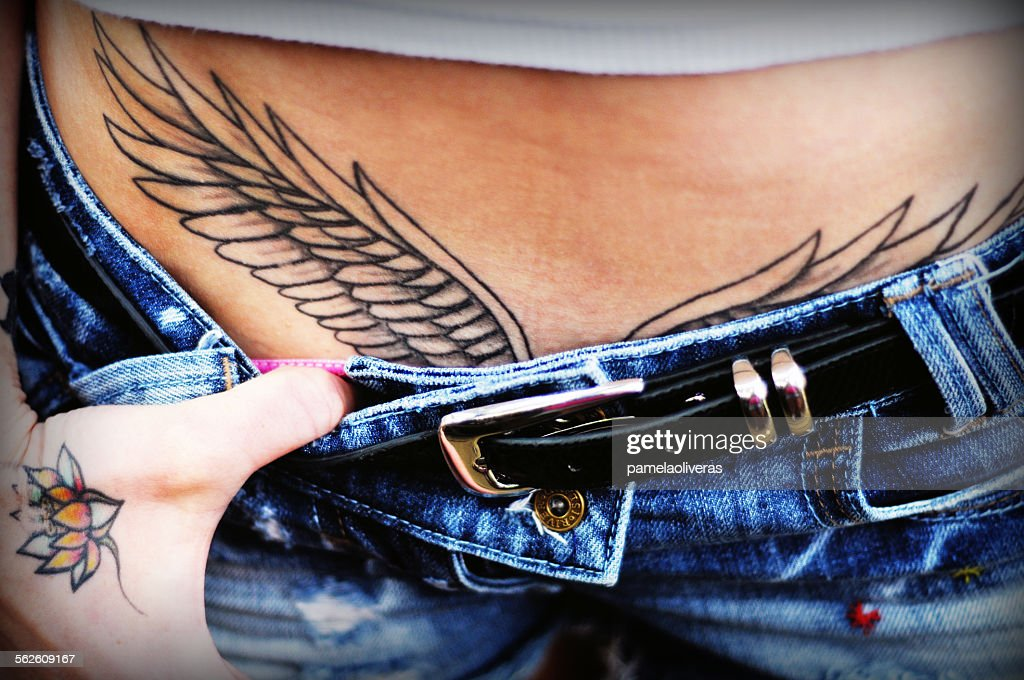 Tattooed wings on a womans body