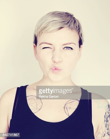 Tattooed woman pulling a funny face