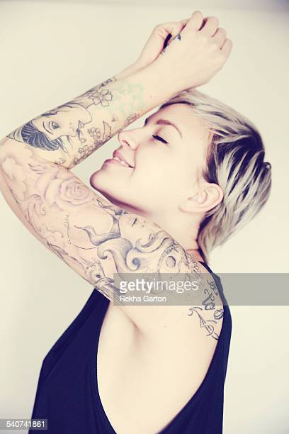 Tattooed woman smiling