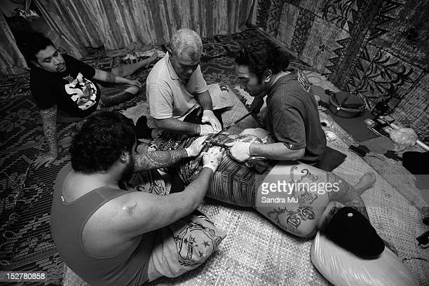Tattooist Kasala Laei Sanele crafts the pe'a traditional Samoan tattooing on July 25 2012 in Auckland New Zealand The pe'a covers the body from waist...