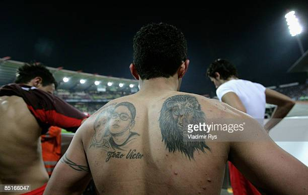 Tattoos on the back of the 01 scorer Elson Falcao da Silva of Stuttgart are seen after the end of the Bundesliga match between Karlsruher SC and VfB...