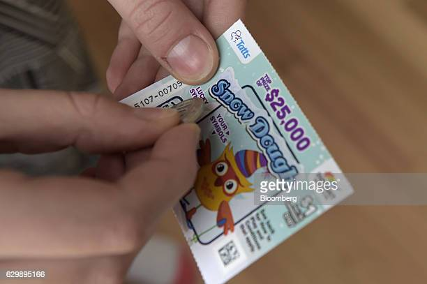 A Tatts Group Ltd Instant ScratchIt scratchcard is arranged for a photograph at a newsagent's store in Melbourne Australia on Thursday Dec 15 2016 A...