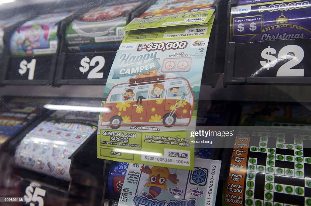 A Tatts Group Ltd. Instant Scratch-It scratchcard is displayed at a newsagent's store in Melbourne, Australia, on Thursday, Dec. 15, 2016. A consortium including Morgan Stanley and KKR & Co. offered as much as A$7.3 billion ($5.5 billion) for Australian betting and lotteries business Tatts Group, setting up a potential bidding war with Tabcorp Holdings Ltd. Photographer: Carla Gottgens/Bloomberg via Getty Images