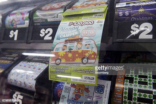 A Tatts Group Ltd Instant ScratchIt scratchcard is displayed at a newsagent's store in Melbourne Australia on Thursday Dec 15 2016 A consortium...