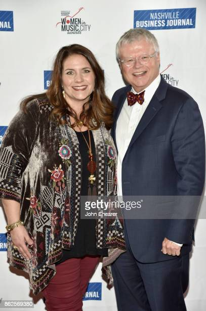 Tatum Allsep of Music Health Alliance and guest arrive at the 2017 Nashville Business Journal Women In Music City on October 17 2017 in Nashville...