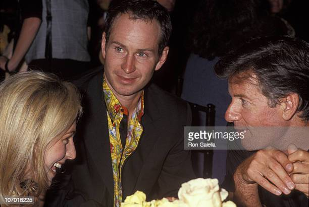 Tatum O'Neal John McEnroe and Calvin Klein during Versace Hosts Rock N' Rule Benefit for AmFAR at Park Avenue Armory in New York City New York United...