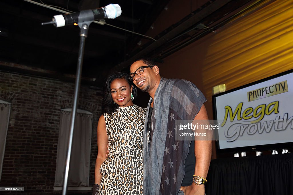 <a gi-track='captionPersonalityLinkClicked' href=/galleries/search?phrase=Tatyana+Ali&family=editorial&specificpeople=847071 ng-click='$event.stopPropagation()'>Tatyana Ali</a> and <a gi-track='captionPersonalityLinkClicked' href=/galleries/search?phrase=Laz+Alonso&family=editorial&specificpeople=2179533 ng-click='$event.stopPropagation()'>Laz Alonso</a> host the relaunch of MegaGrowth at 'The Mane Event' at King Plow Arts Center on April 11, 2013, in Atlanta, Georgia.