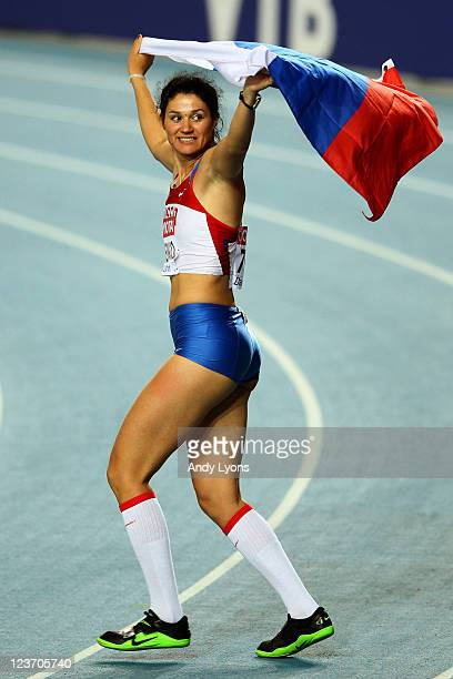 Tatyana Lysenko of Russia celebrates with her country's flag after claiming gold in the women's hammer throw final during day nine of the 13th IAAF...