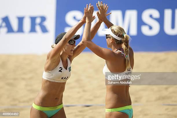 Tatyana Mashkova and Irina Tsimbalova of Kazakhstan celebrates a winning point during the Women's Beach Volleyball Preliminary Round 2014 Asian Games...