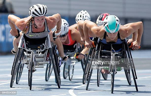 Tatyana McFadden left makes her way past Amanda McGrory right to a firstplace finish in the Women's 1500 Meter Run during the 2016 US Paralympics...