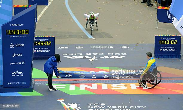 Tatyana McFadden of the United States approaches the finish line to win the Women's Professional Wheelchair Division at TAG Heuer Official Timekeeper...