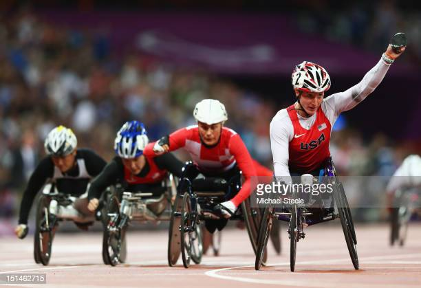Tatyana Mcfadden of the United States celebrates as she crosses the line to win gold ahead of silver medallist Edith Wolf of Switzerland in the...