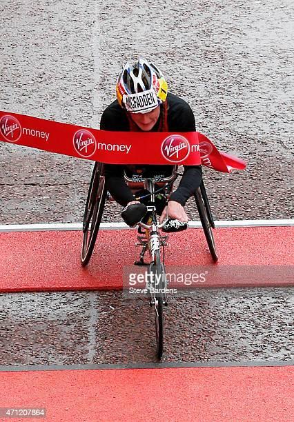 Tatyana McFadden of the United States crosses the finish line to win the Women's wheelchair Virgin Money London Marathon on April 26 2015 in London...