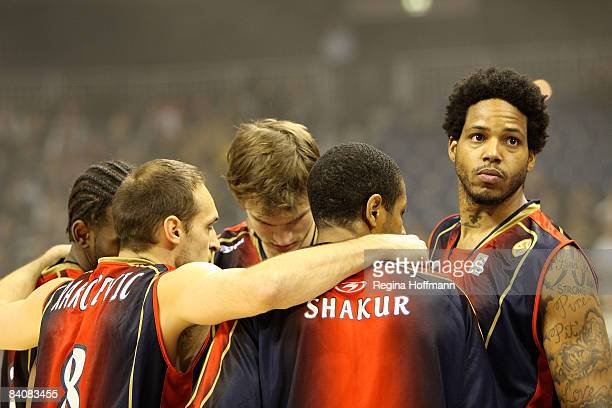 Tau Vitoria players huddle during the Euroleague Basketball Game 8 match between Alba Berlin v Tau Ceramica on December 18 2008 at the O2 World Arena...