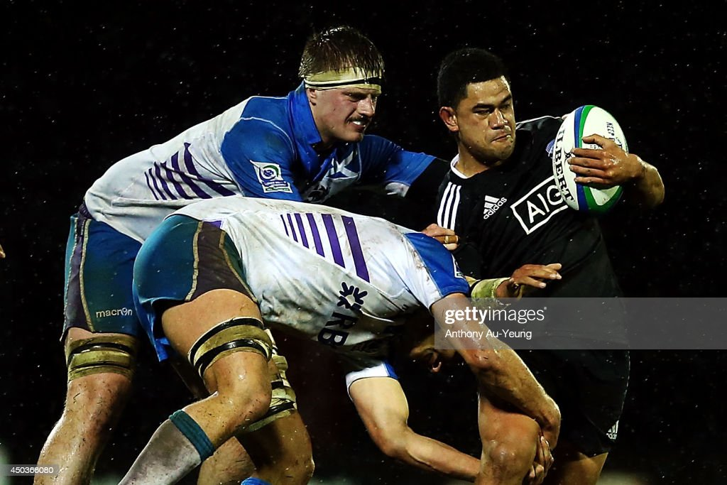 Tauasosi Tuimavave of New Zealand on the charge against Andy Cramond and James Ritchie of Scotland during the 2014 Junior World Championship match between New Zealand and Scotland at ECOLight Stadium, Pukekohe on June 10, 2014 in Auckland, New Zealand.