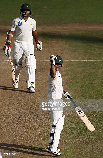 Taufeeq Umar and Mohammad Hafeez of Pakistan celebrate beating New Zealand by 10 wickets during day three of the First Test match between the New...