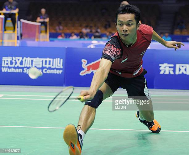 Taufik Hidayat of Indonesia returns the shuttlecock against Carl Baxter of England during their Group A match at the Thomas Cup world badminton team...