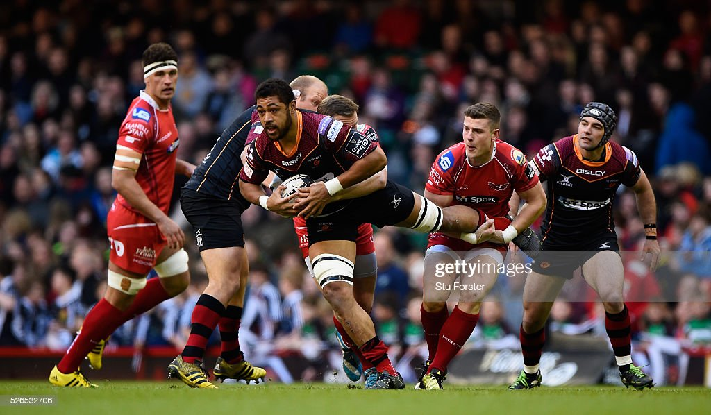 Taulupe Faletau is tackled by Scott Williams of the Scarlets during the Guinness Pro 12 match between Newport Gwent Dragons and Scarlets at Principality Stadium on April 30, 2016 in Cardiff, United Kingdom.