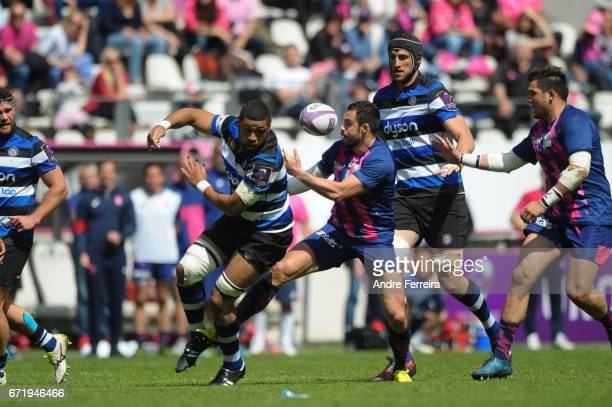 Taulupe Faletau of Bath and Geoffrey Doumayrou of Stade Francais during the European Challenge Cup semi final between Stade Francais and Bath on...