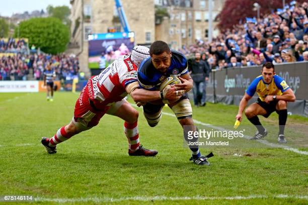 Taulupe Faletau of Bath dives to touch down a try during the Aviva Premiership match between Bath Rugby and Gloucester Rugby at the Recreation Ground...