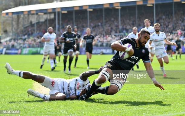 Taulupe Faletau of Bath holds off Benito Masilevu of Brive to score his side's first try during the European Rugby Challenge Cup Quarter Final match...
