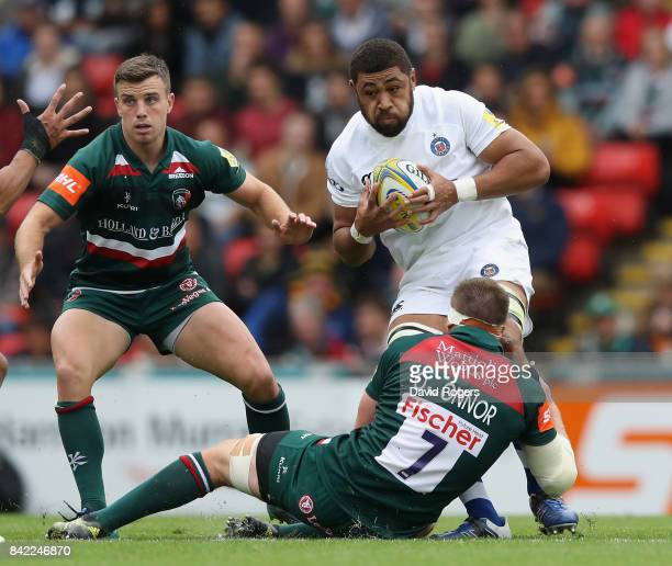 Taulupe Faletau of Bath is tackled by Brendon O'Connor during the Aviva Premiership match between Leicester Tigers and Bath Rugby at Welford Road on...
