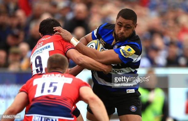 Taulupe Faletau of Bath is tackled by Jonny Arr of Worcester during the Aviva Premiership match between Bath Rugby and Worcester Warriors at...