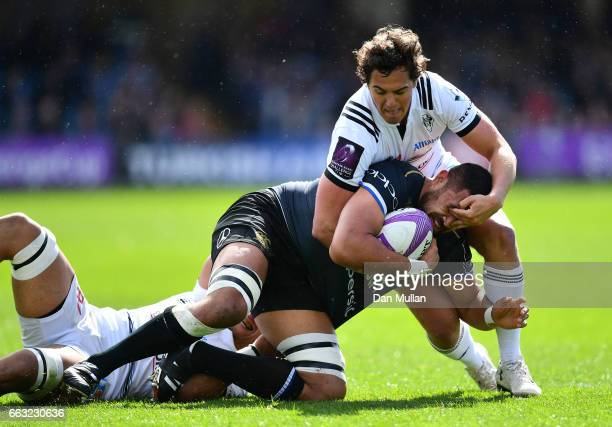 Taulupe Faletau of Bath is tackled by Matthieu Ugalde of Brive during the European Rugby Challenge Cup Quarter Final match between Bath Rugby and...