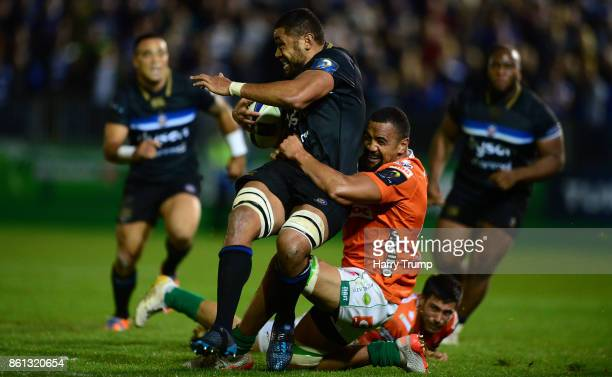 Taulupe Faletau of Bath Rugby is tackled by Nasi Manu of Benetton Rugby during the European Rugby Champions Cup match between Bath Rugby and Benetton...