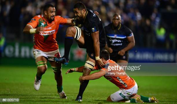 Taulupe Faletau of Bath Rugby is tackled by Nasi Manu of Benetton Rugby and Edoardo Gori of Benetton Rugby during the European Rugby Champions Cup...