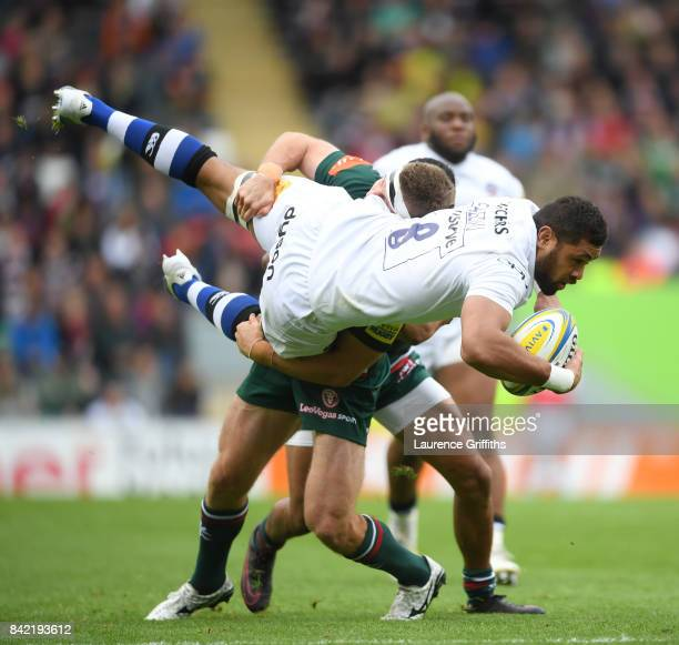 Taulupe Faletau of Bath Rugby is taken off his feet by Nick Malouf of Leicester Tigers during the Aviva Premiership match between Leicester Tigers...