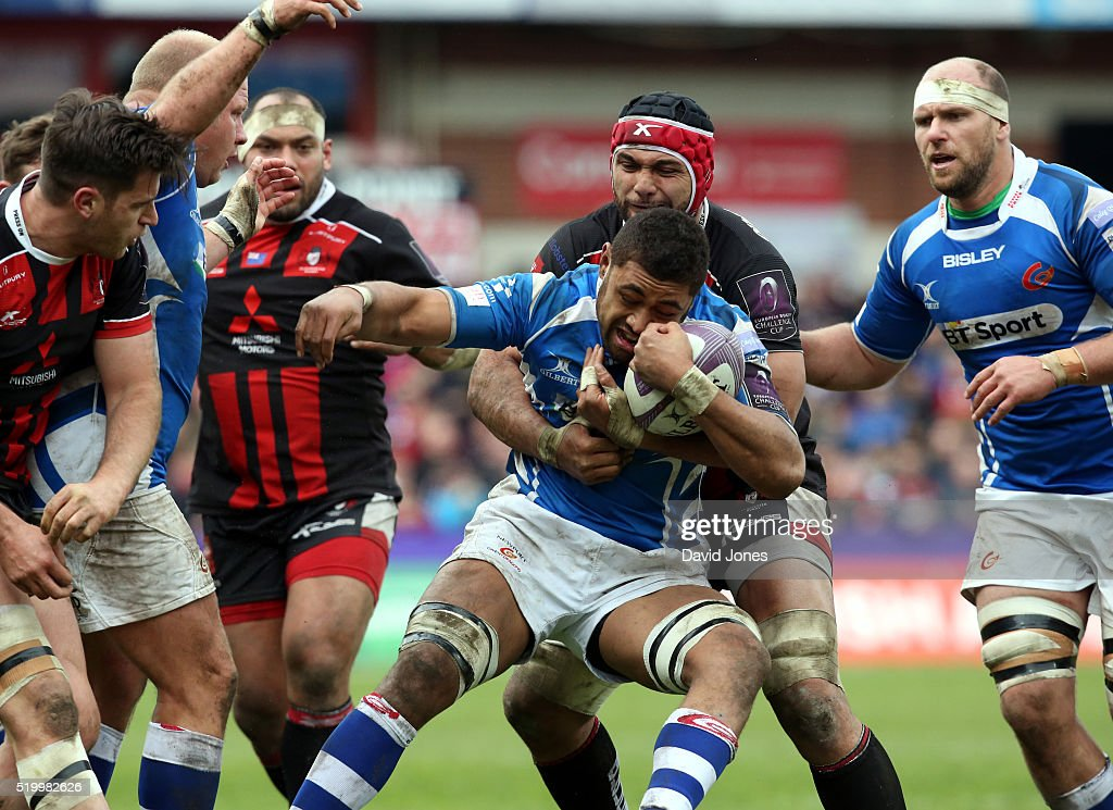 Newport Gwent United Kingdom  city pictures gallery : Taulupe Faletau of Newport Gwent Dragons is held by Sione Kalamafoni ...