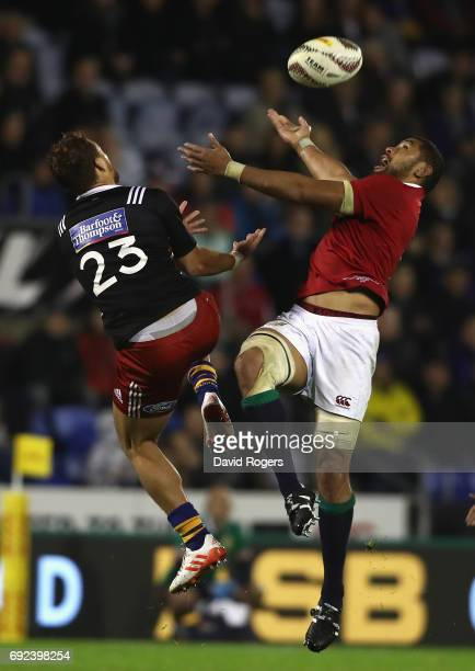 Taulupe Faletau of the Lions attempts to gather the ball as Joe Webber challenges during the match between the New Zealand Provincial Barbarians and...