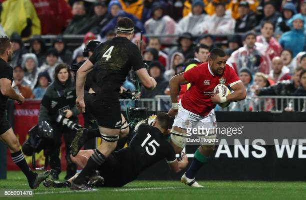 Taulupe Faletau of the Lions barges through the New Zealand defence to score the opening try during the second test match between the New Zealand All...