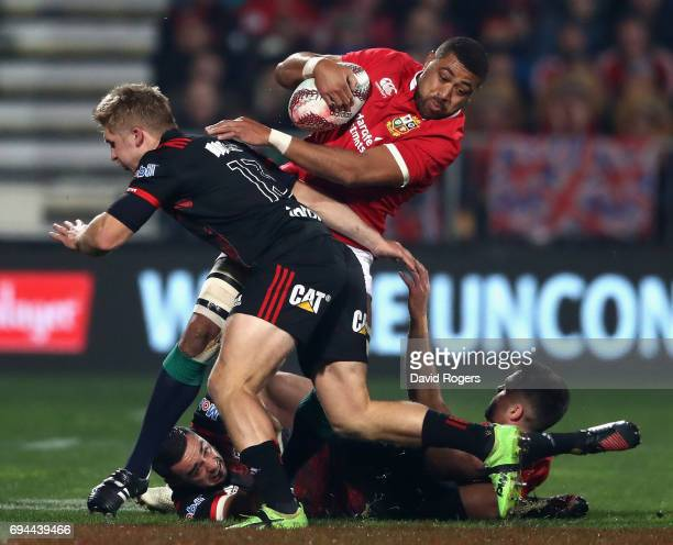 Taulupe Faletau of the Lions catches the ball as Jack Goodhue challenges during the match between the Crusaders and the British Irish Lions at AMI...