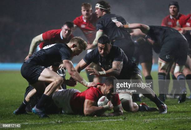 Taulupe Faletau of the Lions is hauled down short of the tryline during the 2017 British Irish Lions tour match between the Maori All Blacks and the...