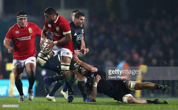 Taulupe Faletau of the Lions is tackled by Elliot Dixon during the match between the New Zealand Maori and the British Irish Lions at Rotorua...