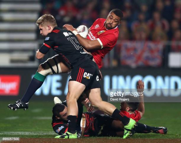 Taulupe Faletau of the Lions is tackled by Jack Goodhue during the match between the Crusaders and the British Irish Lions at AMI Stadium on June 10...
