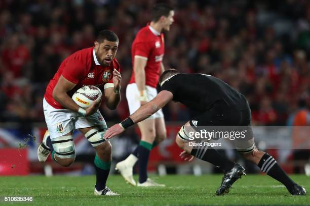 Taulupe Faletau of the Lions is tackled by Kieran Read of the All Blacks during the third test match between the New Zealand All Blacks and the...