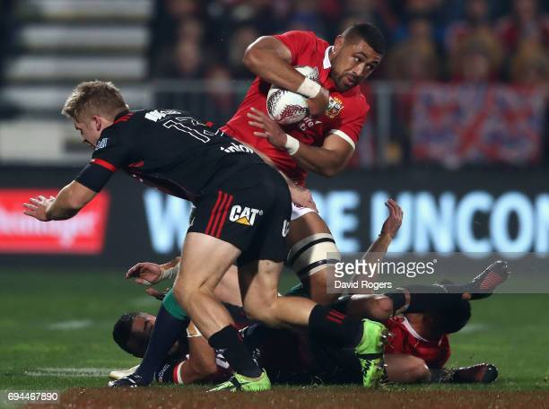 Taulupe Faletau of the Lions runs with the ball as Jack Goodhue challenges during the match between the Crusaders and the British Irish Lions at AMI...