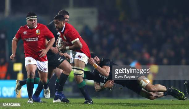 Taulupe Faletau of the Lions tackled by Elliot Dixon of the Maori All Blacks during the 2017 British Irish Lions tour match between the Maori All...